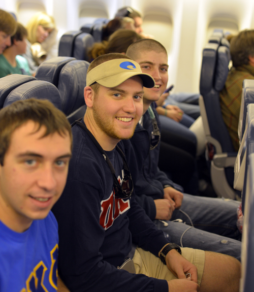 Happy students on the flight
